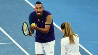 Australia's Nick Kyrgios (L) talks to the umpire as he plays against France's Ugo Humbert during their men's singles match on day three of the Australian Open tennis tournament in Melbourne on Wednesday. Photo: William West/AFP