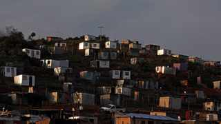 A cross is placed on top of a hill as shacks are seen beneath, amid a nationwide coronavirus disease (Covid-19) lockdown in Freedom Park, south of Johannesburg. Picture: Siphiwe Sibeko/Reuters
