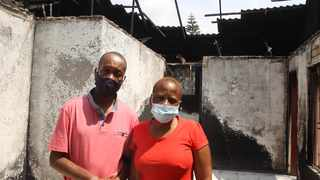 Johannes and Joyce Lebudi in front of their Morula View, Mabopane house, which was gutted by fire on January 3. Jacques Naude African News Agency (ANA)