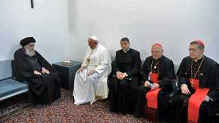 Iraq's most revered Shi'a cleric, Grand Ayatollah Ali al-Sistani (L) meeting with Pope Francis and his delegation, at his home in the holy city of Najaf, while accompanied by Cardinal Louis Raphael I Sako (2nd-R), Patriarch of Babylon of the Chaldeans and head of the Chaldean Catholic Church. Picture: Ayatollah Sistani's Media Office/AFP