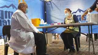 Professor Salim Abdool Karim is one of more than 11 000 healthcare workers who were vaccinated in the province. He is seen with Sister Ailene Abrams at St Augustine's vaccine centre. Picture: Se-Anne Rall