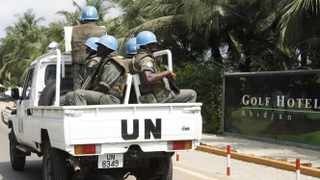 UN forces patrol outside the Golf Hotel in Abidjan. The United Nations has said at least 173 people have been killed and dozens of others have gone missing or been tortured following Ivory Coast's disputed presidential election.