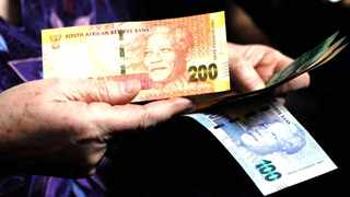 The Treasury has forecast that debt service costs will rise to R338.6 billion in 2023/24 from R162.6 billion in 2017/18. (AP Photo/Denis Farrell)