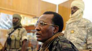 In this file photo taken on February 06, 2008 Chadian President Idriss Deby Itno gives a press conference after a meeting with French Defence Minister Herve Morin (not in photo), in Ndjamena during an official visit to Chad. - Chadian President Idriss Déby Itno, who has been in power for 30 years, died on April 20, 2021 from injuries sustained while commanding his army in fighting against rebels in the north over the weekend, a spokesman announced on state television. (Photo by Pascal GUYOT / AFP)