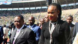 Zimbabwean Deputy President Constantino Chiwenga is seen with his wife Marry Mubaiwa who has been charged with attempting to kill her husband, money laundering and fraud. Picture: Wonder Mashura/AP