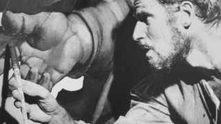 Actor Charlton Heston portrays artist Michelangelo in this scene from the 1965 film The Agony And The Ecstasy