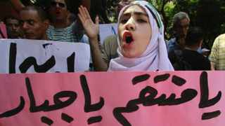 An anti-Syrian regime protester, shouts slogans during a demonstration to show support to the Syrian protesters, in Cairo, Egypt.