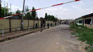 Nigerian security personnel seal the scene of a bomb attack in Kano.