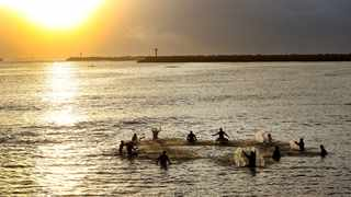 Christian surfers mark Easter with a paddle out at dawn. Picture: Shelley Kjonstad/ANA