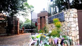 "Flowers are laid at the gate of the Parktown Boys High School after a learner Enock Mpianzi's body was found on Friday after he went missing during a ""water activity"" at the camp in North West. Picture:Nokuthula Mbatha /AfricanNewsAgency(ANA)"