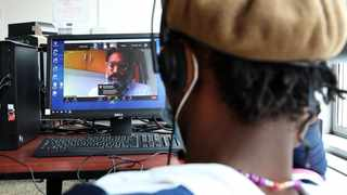 A member of Durban's homeless community in the computer room at the Denis Hurley Centre participates in the fourth annual National Conversation about Homelessness on Zoom.