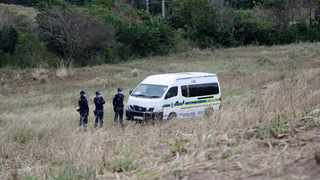 Police on the scene near Mtwalume where a woman's body was found in the bush. Picture: Bongani Mbatha/African News Agency (ANA)