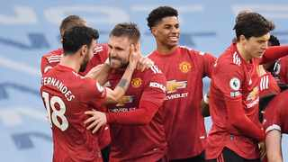 Manchester United's Luke Shaw celebrates with teammates after scoring their second goal during their Premier League clash against Manchester City at the Etihad Stadium in Manchester on Sunday. Photo: Peter Powell/Reuters