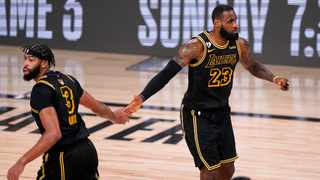 Los Angeles Lakers' Anthony Davis (3) and LeBron James (23) celebrate a basket against the Miami Heat during the second half of Game 2 of the NBA Finals. Photo: Mark J. Terrill/AP