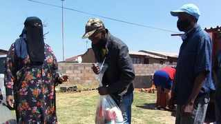 Community members collecting food parcels. Image supplied.