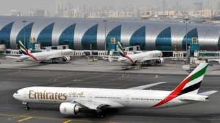 An Emirates plane taxis to a gate at home base Dubai International Airport in Dubai, United Arab Emirates. (File photo.)