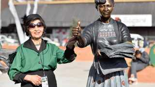 Sophie de Bruyn next to her statue at the Living Women's Monument on Lillian Ngoyi Square in Pretoria. File picture: Phill Magakoe/African News Agency