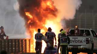 Flames seen from the crash scene after Haas' Romain Grosjean crashed out at the start of the race. Photo: Kamran Jebreili/Reuters