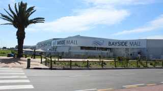 LARNEY ENTRY: The skelms arrived at Bayside Mall in a smart black Lexus