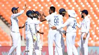 India's Ravichandran Ashwin (C) celebrates with teammates after taking the wicket of England's Ollie Pope. Photo: Sajjad Hussain/AFP