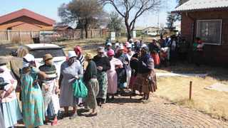 Residents from Phiri, Soweto queue for food parcels. Picture: Bhekikhaya Mabaso/African News Agency (ANA)