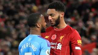 Liverpool's Joe Gomez, right, and Manchester City's Raheem Sterling clash during the Premier League soccer match at Anfield on Sunday. Photo: Peter Byrne/PA via AP