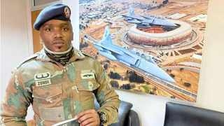 Captain Wanda Zondi holds up a copy of his book 'No Easy Battle'. | Picture: Kevin Ritchie.