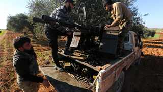 Turkish backed Syrian fighters load ammunition at a frontline near the town of Saraqib in Idlib province, Syria. File picture: AP Photo/Ghaith Alsayed