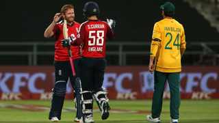 Jonny Bairstow of England and Sam Curran of England celebrate as England beat South Africa by 5 wickets during the 1st KFC T20 International match between South Africa and England held at Newlands Cricket Ground in Cape Town, South Africa on 27 November 2020. Photo: Shaun Roy/BackpagePix
