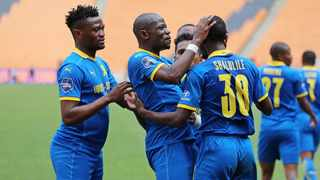 Mamelodi Sundowns' Peter Shalulile celebrates with team-mates after scoring the opening goal of their DStv Premiership match against Kaizer Chiefs at FNB Stadium in Johannesburg on Saturday. Photo: Muzi Ntombela/BackpagePix