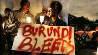 epa05068058 A Burundian expatriate woman holds a placard reading 'Burundi bleeds' during a candlelight vigil held for Burundi in Nairobi, Kenya, 13 December 2015. Kenyan activists and Burundians residing in Kenya held a candlelight service to call for peace in Burundi, that has been gripped by violence between police and armed groups since April, when President Pierre Nkurunziza announced he would seek a third term in office. Human rights activists say more than 240 people have been killed in protests and attacks since April, while more than 220,000 are believed to have fled the country. EPA/DAI KUROKAWA