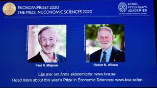 Pictures of the winners of the 2020 Nobel prize in economic sciences, Paul R. Milgrom and Robert B. Wilson, are displayed on a screen in Stockholm, Sweden. Picture: TT News Agency/Anders Wiklund via Reuters