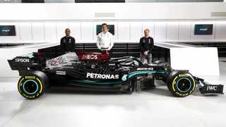Toto Wolff (centre) poses with the 2021 W12 E Mercedes-AMG F1 car.