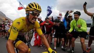 France's Julian Alaphilippe wearing the overall leader's yellow jersey climbs the Galibier pass during the eighteenth stage of the Tour de France. Photo: Christophe Ena/AP Photo