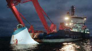 The bow door of the sunken passenger ferry M/S Estonia is lifted up from the bottom of the sea, off Uto Island, in the Baltic Sea, in November 1994. File picture: Jaakko Aiikainen/Lehtikuva via AP