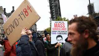 Anti-lockdown protesters take part in a march, amid the coronavirus disease (COVID-19) outbreak, in London. Picture: Henry Nicholls/Reuters