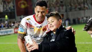 """Catalans Dragons player Israel Folau takes a picture with a young fan after a Super League match. Picture"""" Joan Monfort/AP"""