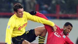 FILE - Dortmund's Christoph Metzelder, left, jumps, as he challenges for the ball with Lokomotiv's James Obiorah during the Champions League game between FC Lokomotiv Moscow and Borussia Dortmund in 2002 . Photo: Ivan Sekretarev/AP Photo
