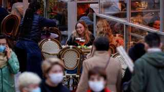 People sit in a cafe in Lille France. Reuters