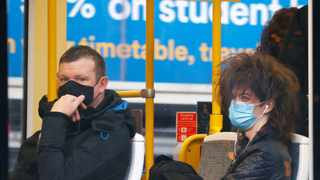 People wear protective masks as they ride on a tram, amid the outbreak of Covid-19 in Manchester, Britain. Picture: Phil Noble/Reuters