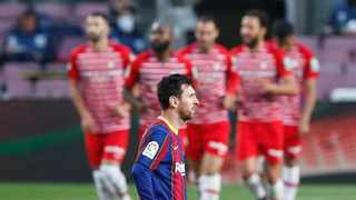 Barcelona's Lionel Messi looks dejected after Granada's Jorge Molina scored their second goal. Photo: Albert Gea/Reuters