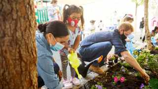 Prince Harry and Meghan Markle, the Duke and Duchess of Sussex, plant flowers and forget-me-nots during a visit to the Assistance League Los Angeles' Preschool Learning Center last month. Picture: Matt Sayles via Reuters