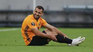 Wolverhampton Wanderers' Jonny sits on the ground after sustaining a knee injury during their Europa League clash against Olympiakos. Photo: Molly Darlington/Reuters