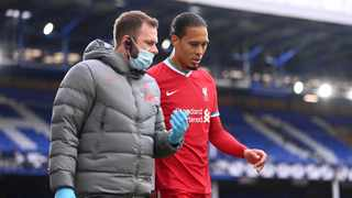 Liverpool's Virgil van Dijk leaves the field after injuring his knee during their Premier League clash against Everton. Photo: Laurence Griffiths/Reuters