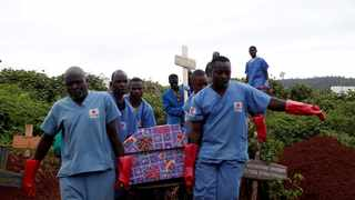FILE PHOTO: Red Cross workers carry the coffin of an Ebola victim to be buried in the eastern town of Butembo in the Democratic Republic of Congo