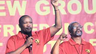 NUMSA's Ivan Jimm alongside Karl Cloete on stage sing worker songs before the opening of the Special National Congress of NUMSA held at Birchwood Hotel in Boksburg on Tuesday. Picture: Timothy Bernard 17.12.2013