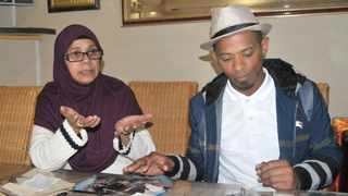 Mujahid George is finally ready to share his story. He is pictured with his mom, Moseda. Picture: Jack Lestrade