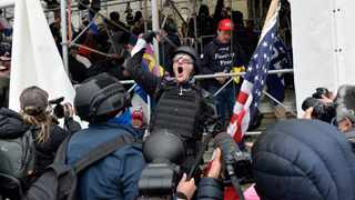 A man calls on people to raid the building as Trump supporters clash with police and security forces as they try to storm the US Capitol in Washington D.C Picture: AFP