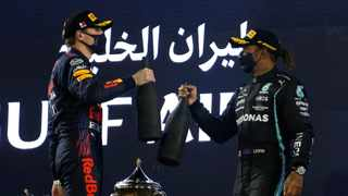 Mercedes' Lewis Hamilton celebrates winning the race on the podium with Red Bull's Max Verstappen. Photo: Hamad I Mohammed/Reuters