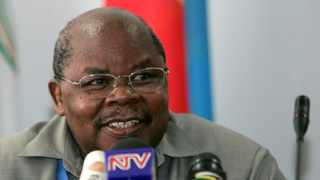 Tanzania's former president Benjamin Mkapa speaks during the third round of peace talks in 2009. Picture: Reuters/Antony Njuguna